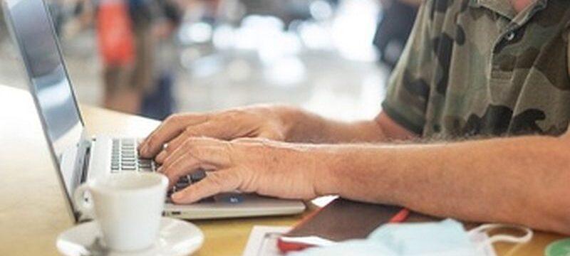 traveler-man-airport-waiting-boarding-works-laptop-computer-senior-blogger-remote-working-hands-keyboard_465191-316