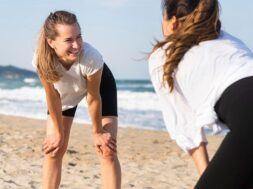 two-women-exercising-together-beach_23-2148694872