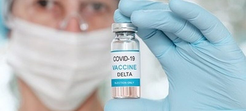 woman-doctor-holding-vial-with-coronavirus-vaccine-covid-delta-variant_85601-942