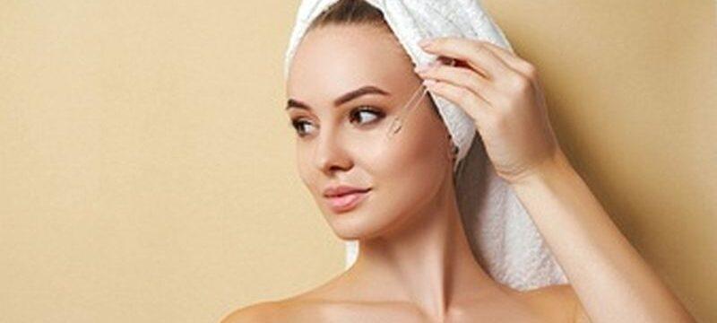 woman-white-towel-applies-serum-face_201606-1644